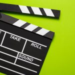movie clapper on green background cinema