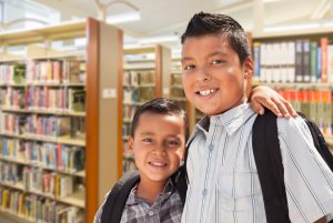 two young ELL boys in library