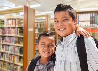 two young boys in library