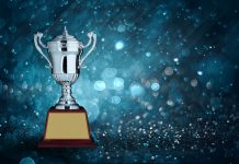 abstract silver trophies with blue bokeh lighting. copy space ready for your trophy award design.