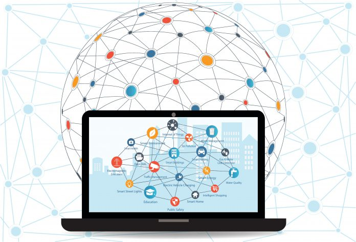 Internet networking concept and Cloud computing technology. Laptop with Smart city in background with different icon and elements.Internet of things/Smart city