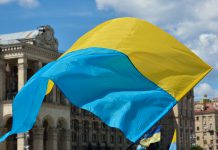 Yellow-blue national banner is fluttering on the wind at the Independence Square in the Ukrainian capital Kyiv.