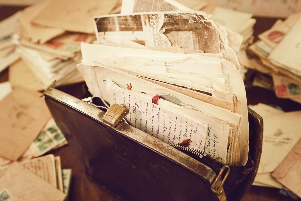 Old papers in a vintage briefcase