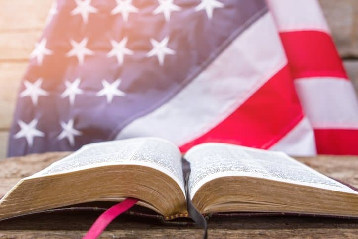Open Bible with American flag in the background