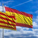 Catalonia and Spain flags waving on blue sky background. 3d illustration