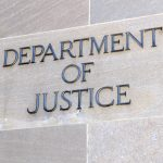 Department of Justice sign, Washington DC, USA.
