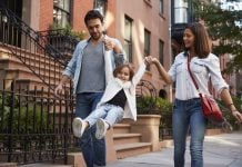 Family taking a walk down NYC street