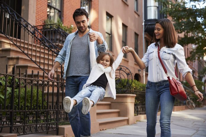 Family taking a walk down NYC street