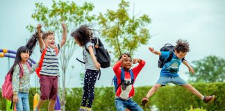 kids preschool kindergarten enjoy and happy jumping on the field of playground after school class is over to returning home