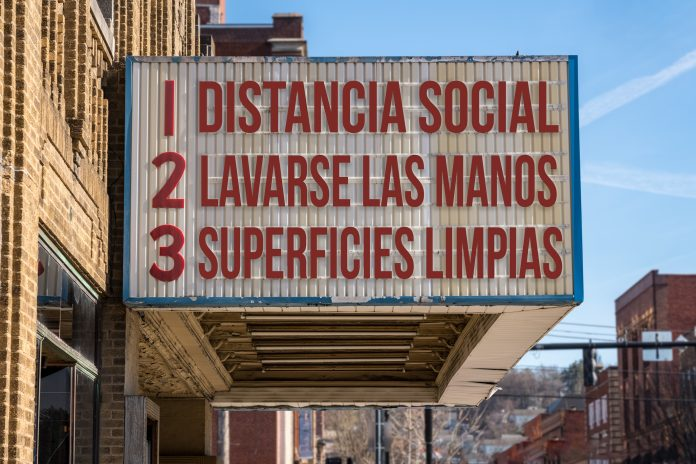Spanish movie cinema billboard with three rules to avoid the coronavirus epidemic. Translation, wash hands, maintain social distance, clean surfaces